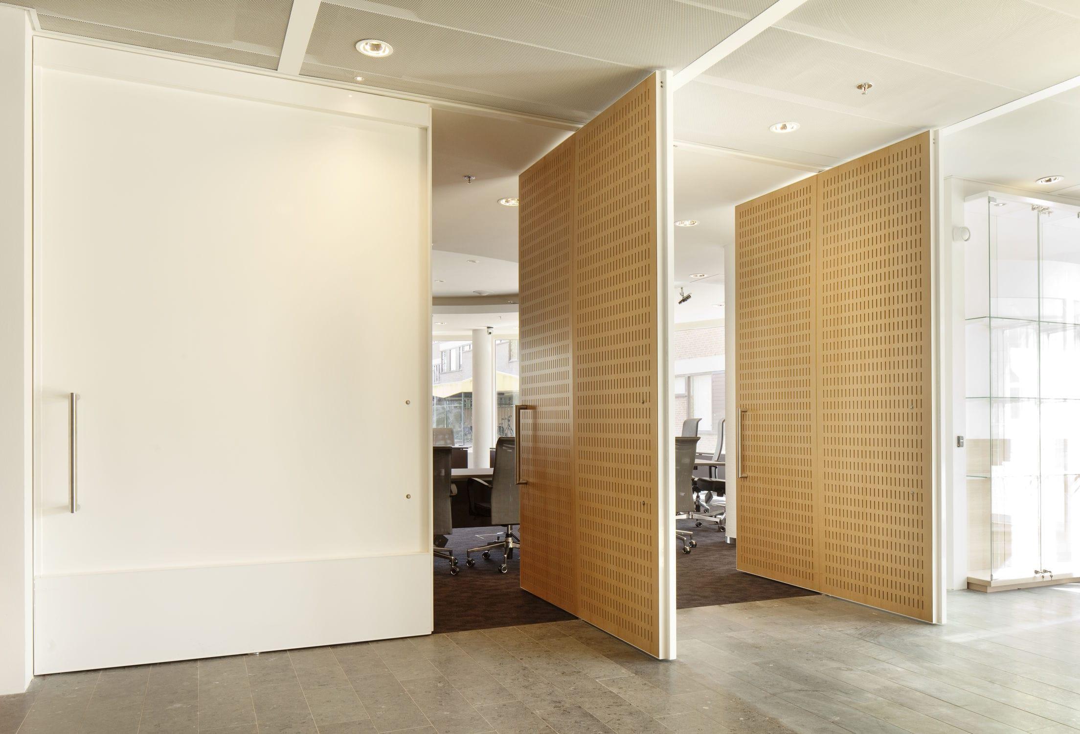 puerta de interior pivotante con eje descentrado de acero by