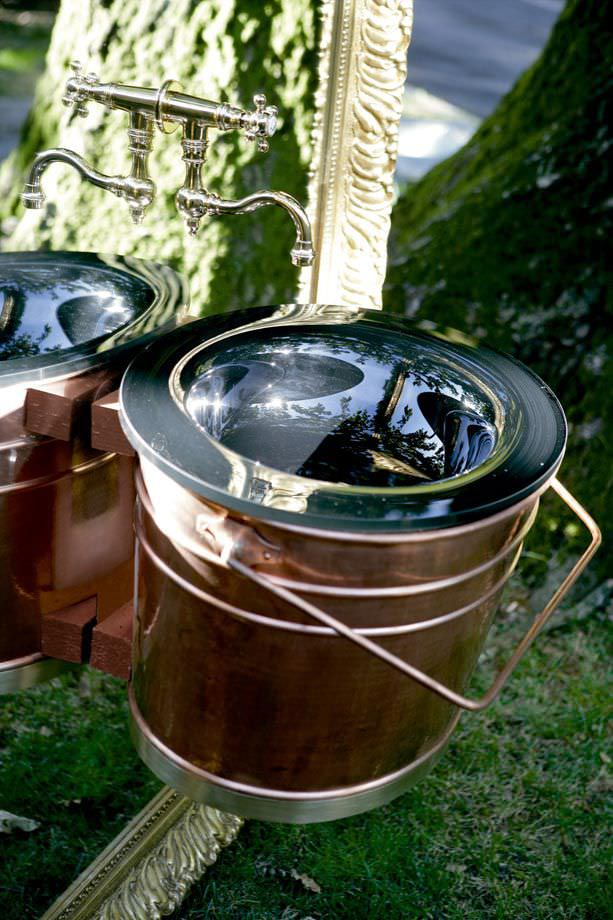 lavabo suspendido ovalado de vidrio de cobre secjo by giorgio soressi altamarea