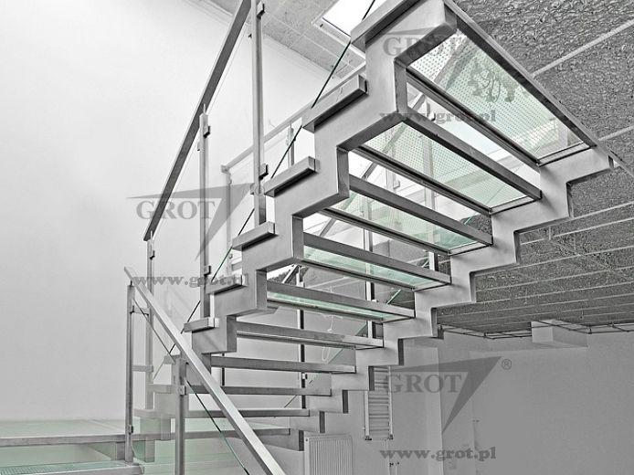 Escalera en U estructura de metal con peldaos de vidrio sin