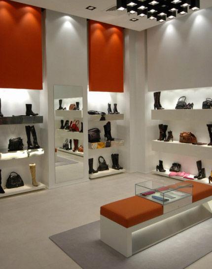 Estantería mural   moderna   de madera   para tienda de zapatos ... d1ddb15354f6