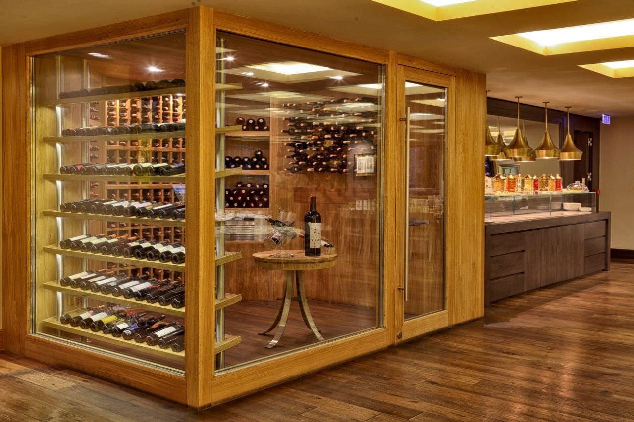 Vinoteca profesional / bajo encimera / de vidrio / de madera ...