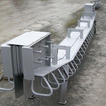 Junta de dilatación de elastómero / de acero / para la construcción de puentes / monocelular