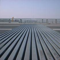 Junta de dilatación de elastómero / para la construcción de puentes / monocelular / modulable