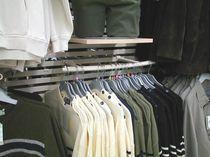 Expositor de pared / para ropa / de metal / para comercio