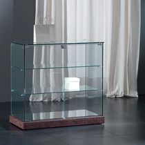 Vitrina moderna / de pie / de vidrio / baja