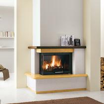 Marco para chimenea moderno / de madera / de piedra / de esquina