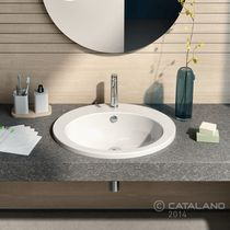 Lavabo encastrable / ovalado / de cerámica / moderno