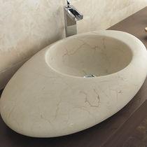 Lavabo sobre encimera / ovalado / de piedra natural / moderno