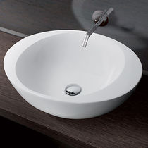 Lavabo sobre encimera / redondo / de cerámica / moderno