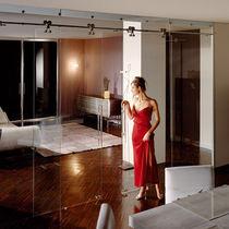 Sistema corredero para puerta de vidrio