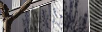 Contraventanas correderas / de aluminio / para fachadas / con celosía