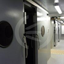 Puerta industrial corredera / de metal / acústica / acristalada