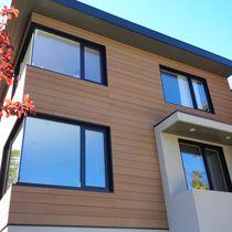 Revestimiento de fachada de WPC / mate / en láminas / aspecto madera