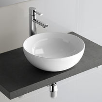 Lavabo sobre encimera / redondo / de porcelana / moderno