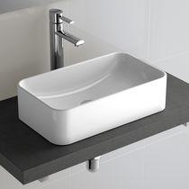 Lavabo sobre encimera / rectangular / de porcelana / moderno
