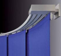 Riel para cortina con accionamiento manual / con fijación mural / para paneles tendidos / para uso doméstico