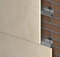 Sistema de fijación metal / para revestimiento de fachada / para interior