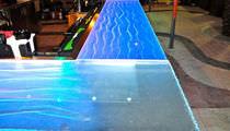 Mostrador de bar / de vidrio / en L / con luz
