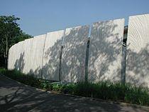 Revestimiento de fachada de hormigón prefabricado / texturado / abujardado / de panel