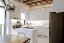 Cocina moderna / de madera lacada / de Corian® / en L