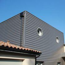 Revestimiento de fachada de acero / acanalado / en láminas