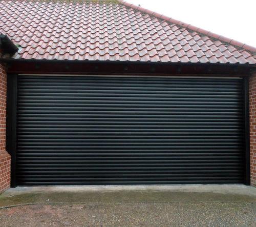 puerta de garaje enrollable / de aluminio / automática / aislante