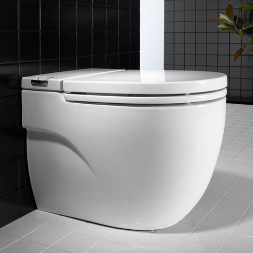inodoro de pie / de porcelana / con cisterna empotrada