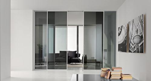 puerta de interior / corredera / de aluminio / suelo-techo