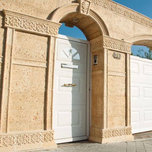 revestimiento de pared de hormigón / para uso residencial / para el sector servicios / texturado