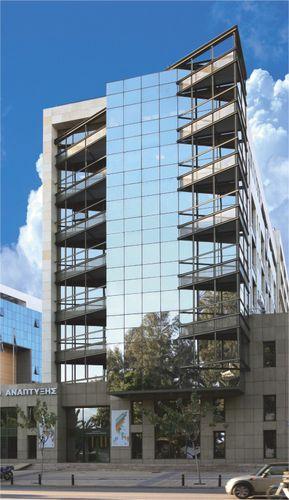 muro cortina de vidrio estructural / de aluminio y vidrio