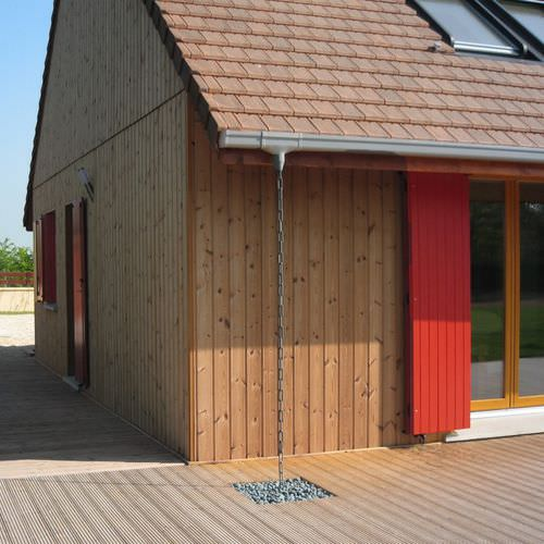 revestimiento de fachada de madera / ranurado / en láminas