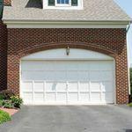 portón seccional / de metal / de láminas / para garaje