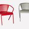 silla de comedor de diseño original / con reposabrazos / de acero con revestimiento en polvo / de exterior