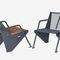 sillón moderno / de madera / de acero con revestimiento en polvo / con reposabrazos