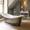 bañera en isla / ovalada / de material compuesto / de piedra