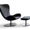 sillón bajo moderno / de tejido / de cuero / con reposapiés