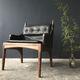 sillón moderno / de cuero / de nogal / negro
