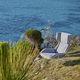sillón moderno / de tejido / de acero / con reposapiés