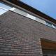 fachaleta de ladrillo de arcilla / para fachada / con relieve / hecho a mano