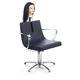 sillón de peluquería de cuero / con base central / con patas en forma de estrella / giratorio