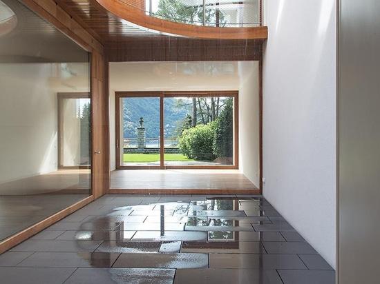 el herzog y de meuron construye ocho chalets en los bancos inclinados del lago Lugano