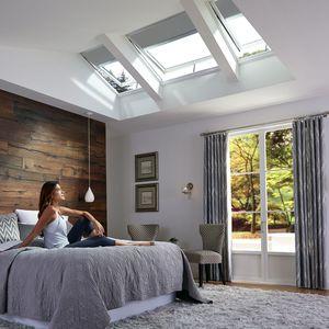 ventana de tejado con captadores solares