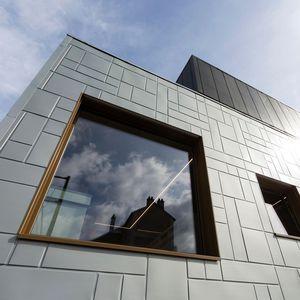 sistema de fachada de titanio