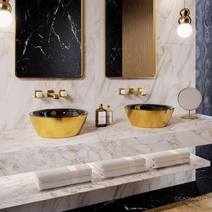 lavabo doble / sobre encimera / redondo / de cerámica