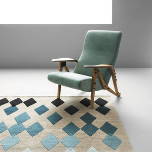 sillón de diseño original / de tejido / de cuero / de roble