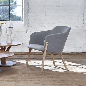 sillón contemporáneo / de cuero / de tejido / de haya