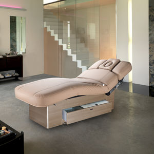 mesa de masaje eléctrica / de madera / con altura regulable / con almacenamiento