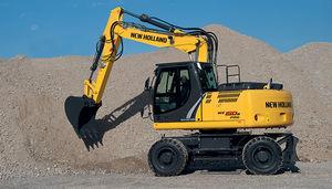 excavadora intermedia / con neumáticos / multiusos / para obra
