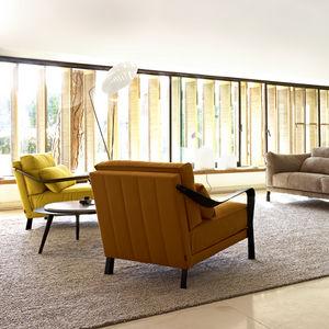 sillón contemporáneo / de tejido / de aluminio fundido / de Pascal Mourgue