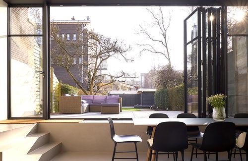 puerta plegable / de interior / de acero / para edificio público